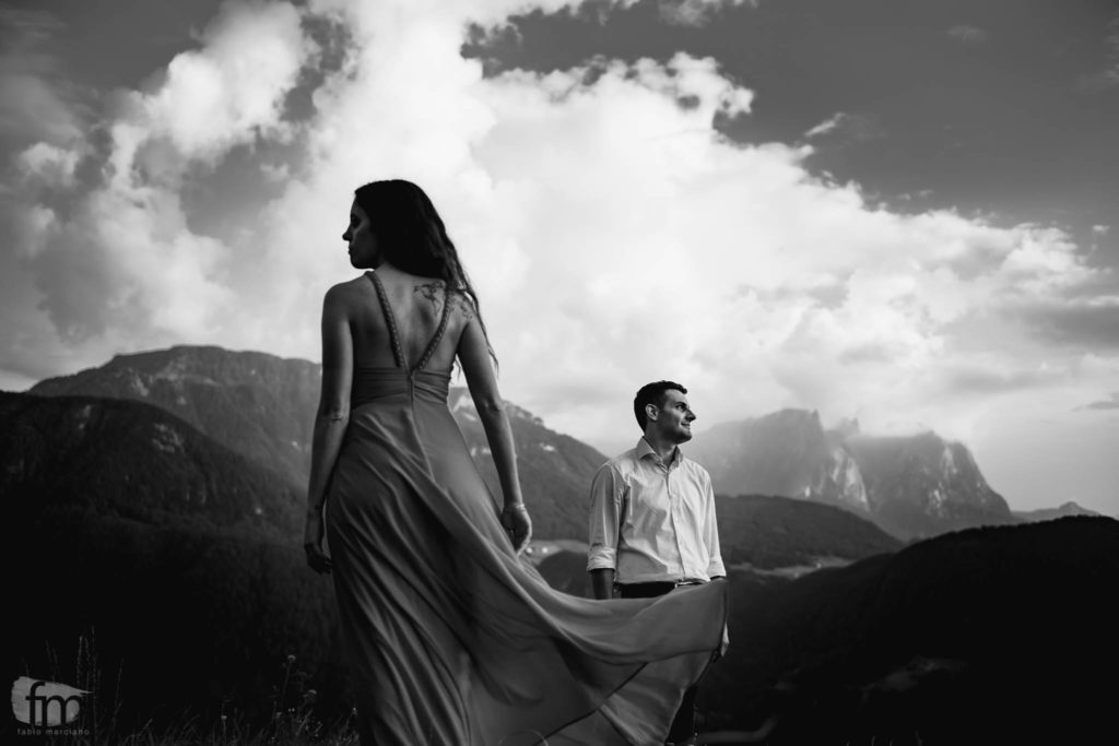 Black white portrait of bride and groom on the mountains.