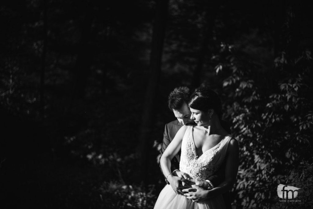 Photo of bride and groom embraced in the grove at Casa Gobbato