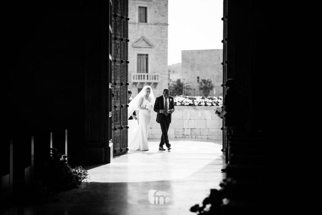 Bride enters the cathedral of trani accompanied by her father