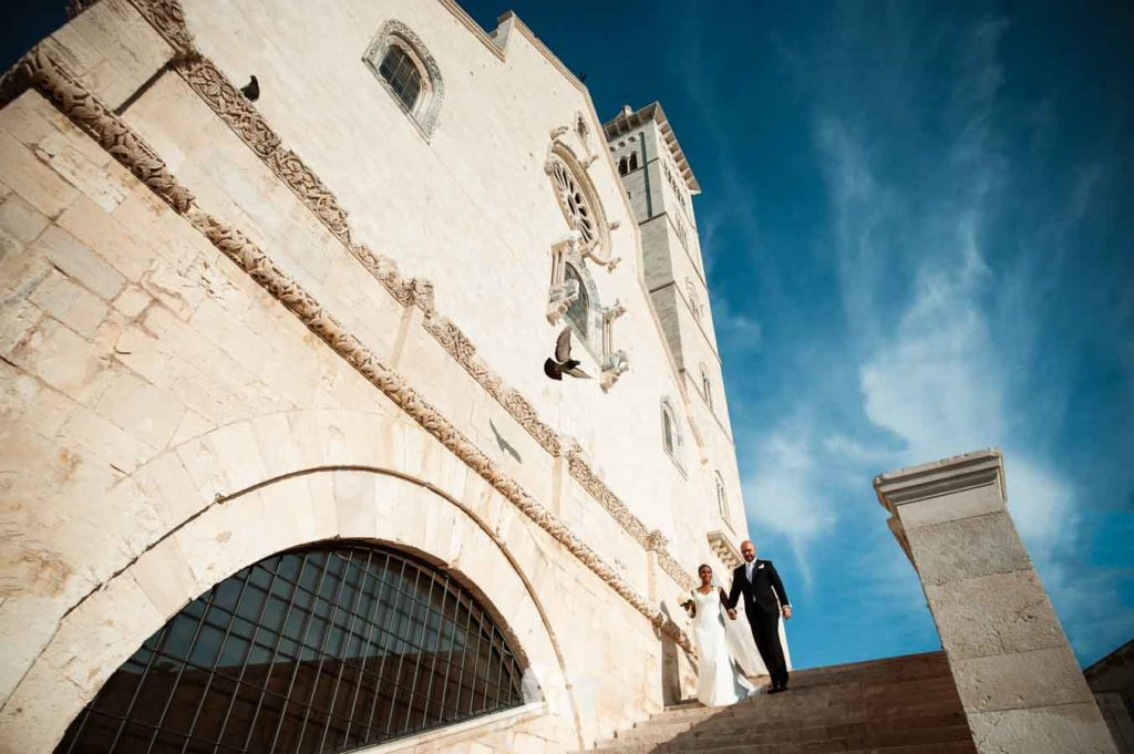 Photo of a married couple at the Cathedral of Trani